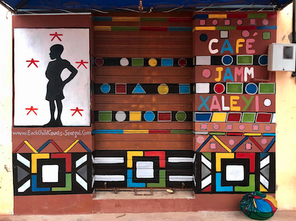 We painted Café Jàmme Xaleyi and now the children have the cutest place in town